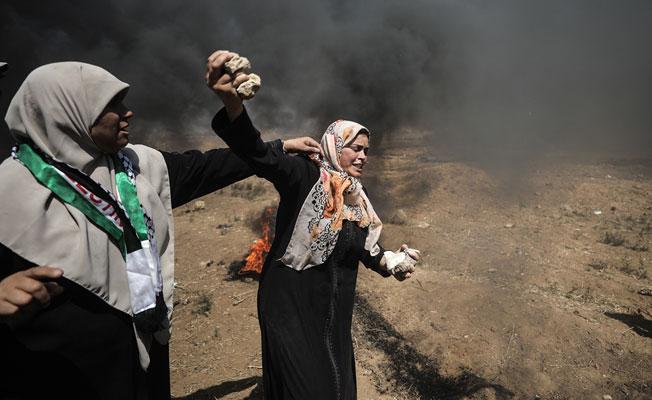 Gazze'de şehit edilen Filistinli sayısı 52'ye yükseldi