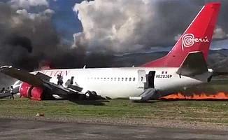İçinde 141 yolcu taşıyan uçak alevler içinde kaldı
