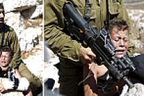 Silahlı İsrail askerinden Filistinli çocuğa şiddet