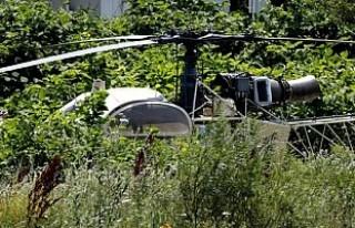 Ünlü gangster silahlı kişiler eşliğinde helikopterle...