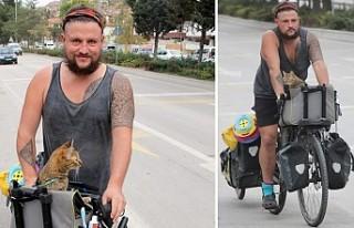 Kedisiyle birlikte İskoçya'dan Tayland'a...